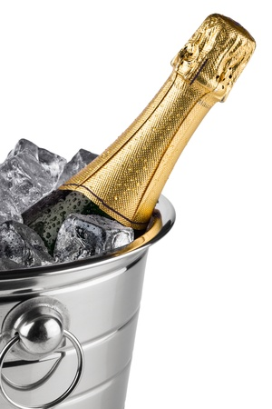 green glass bottle: bottle of champagne in cooler with ice cubes Stock Photo