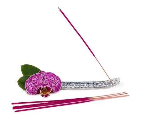 incienso: palo de incienso con la flor de la orquídea