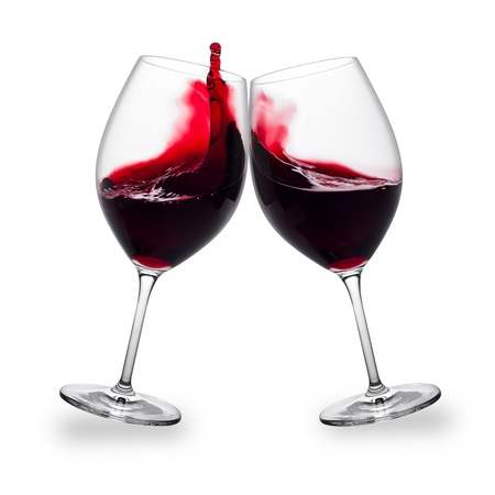 two glasses of red wine with splashes Stock Photo - 19321870