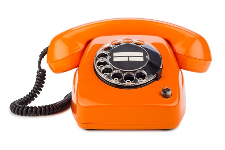 dialplate: an old orange phone with rotary dial