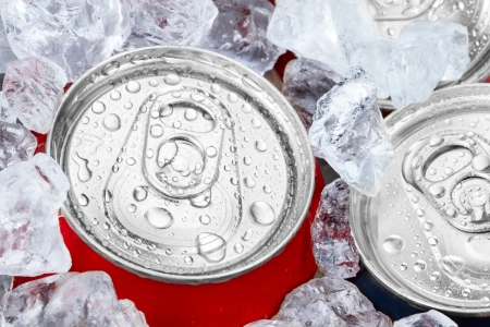 crushed aluminum cans: drink cans with crushed ice Stock Photo