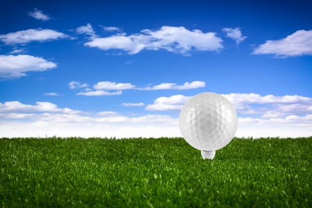 golf  ball on tee on gras photo