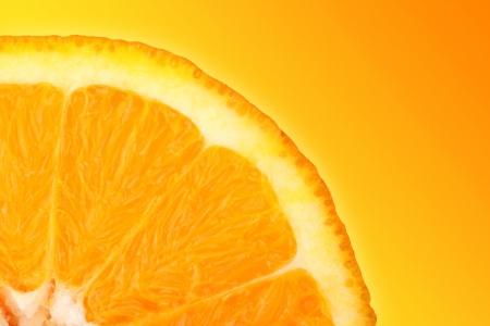 consciously: orange slice in front of yellow orange background