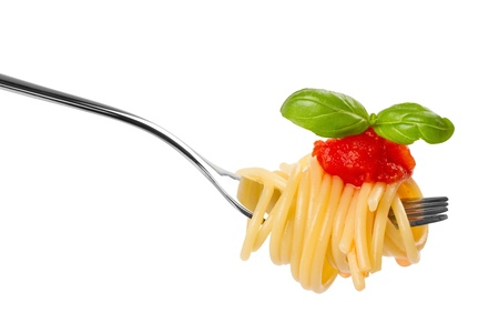 fork with spaghetti sauce and basil on white background