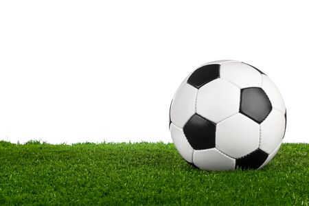 greenfield: a soccerball on a green meadow Stock Photo