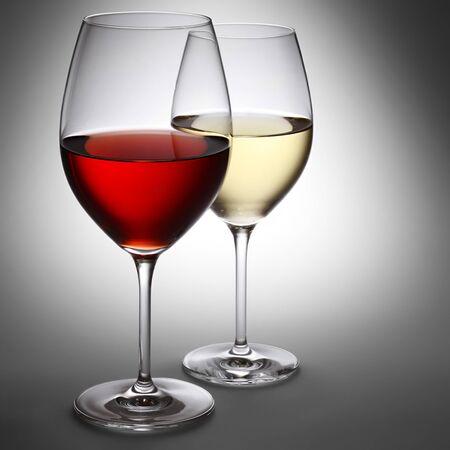 white wine glass: Red wine and white wine in spotlight