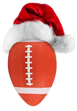 kerstmuts op voetbal op een witte achtergrond Stockfoto