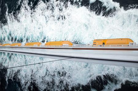evacuate: row of  lifeboats on a cruiseship Stock Photo