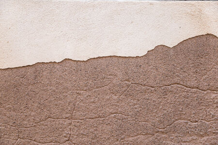 renovate old building facade: texture of an old stone wall