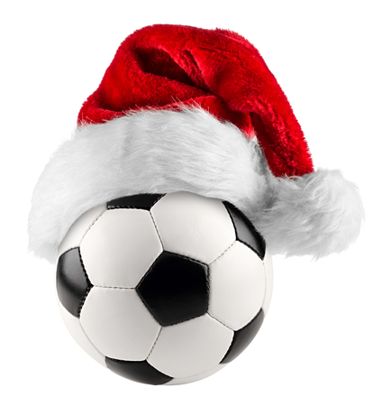 costume ball: santa hat on soccer ball on white background