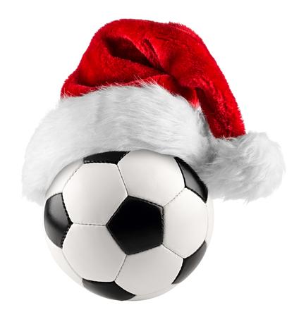 christmas retro: santa hat on soccer ball on white background