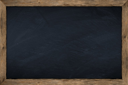 empty chalkboard with wooden frame photo