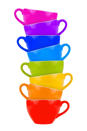 stack of colorful coffee mugs photo