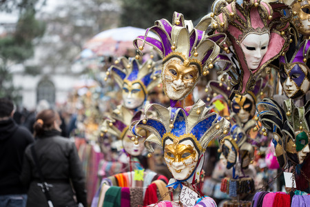 loitering: market stands with souvenir masks from venice  Stock Photo