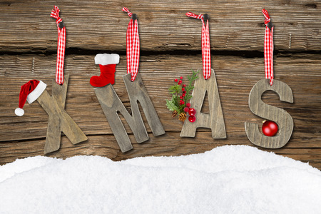 xmas letters with snow on wooden background photo