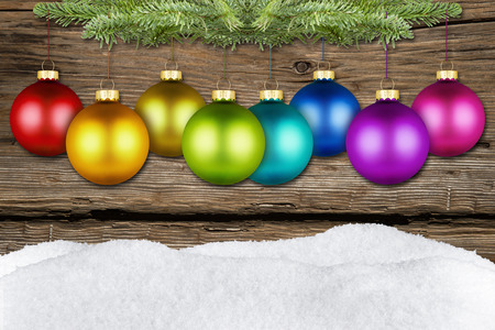 christmas balls on fir branch front of wooden background Stock Photo - 26055078