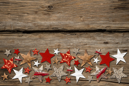 row of colorfull christmas stars on wooden background Stock Photo - 26055080