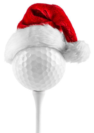 christmas ball isolated: golf ball on tee with santa hat