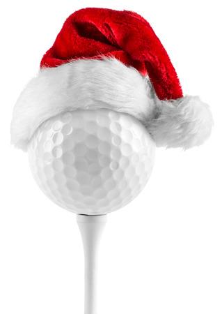 golfbal op de tee met kerstmuts