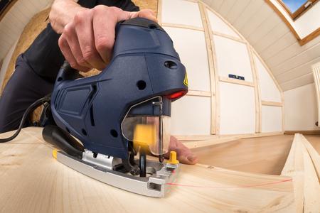 housebuilding: jigsaw at work cutting plywood