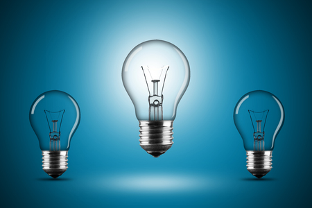 e27: row of light bulbs on blue background Stock Photo