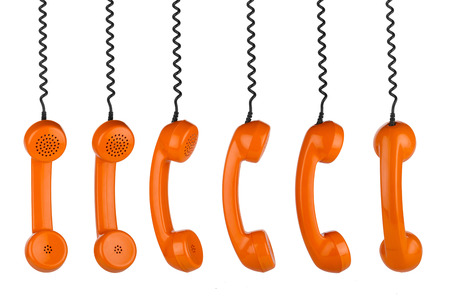 row of old handsets on white background photo