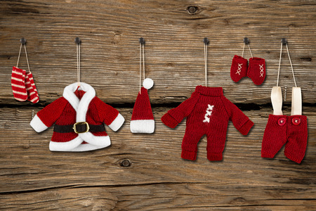 santa clothes hanging in front of wooden background Stock Photo - 26055120