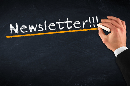 newsletter: chalkboard with hand and Newsletter drawing