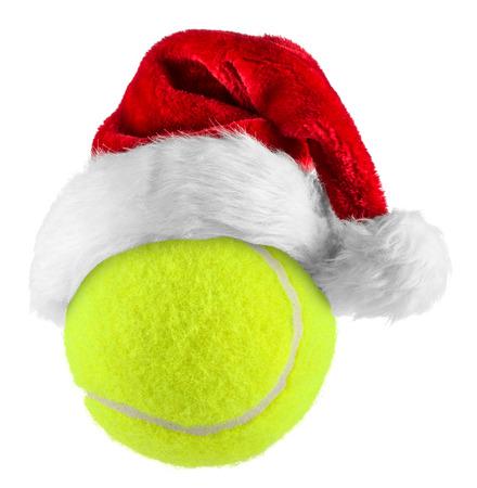 merry xmas: santa hat on tennis ball on white background