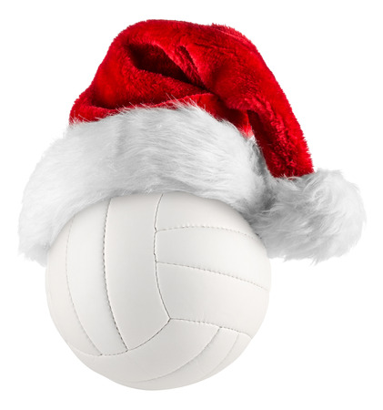 beach volleyball: santa hat on volleyball on white background