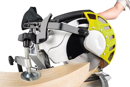 miter: miter saw cutting a wooden beam