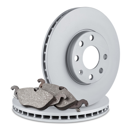 pair of car brake discs and pads on white background