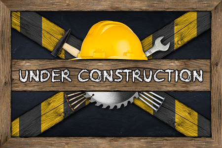 Under Construction concept on blackboard photo