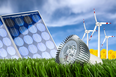 led bulb in front of solar cell and wind turbines photo