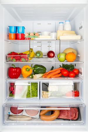 refrigerator with food: open refrigeratored filled with food