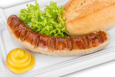german grilled sausage with mustard and salad