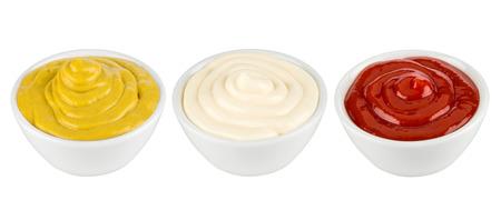 dip: ketchup, mustard and mayonnaise in ceramic bowles