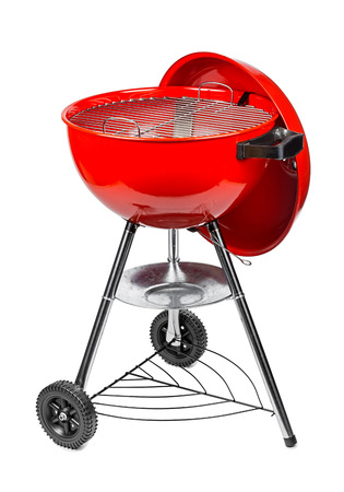 red kettle grill in front of white background Stock Photo
