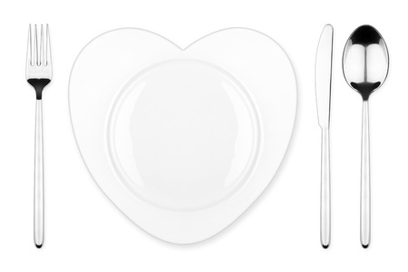 place setting with heart shaped plate photo
