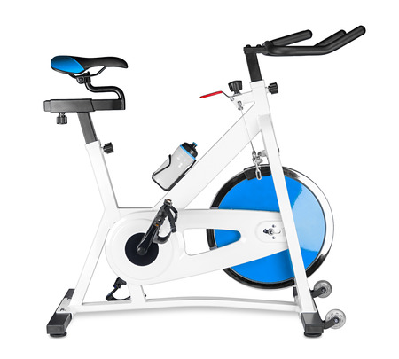 stay on course: excercise bike on white background Stock Photo