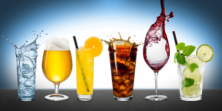Row of various drinks on blue background photo