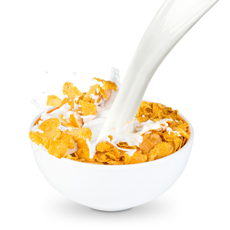 milk splashes into corn flakes bowl