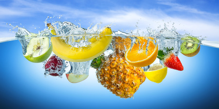 of fruit: many fruits splashes into water