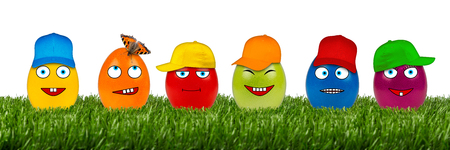 row of funny easter eggs on white background photo