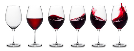 white wine: row of red wine glasses, full, empty and with splashes.