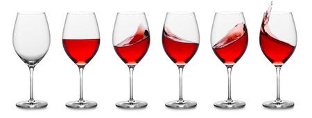 rij van rose wijn glazen, vol, leeg en met spatten.