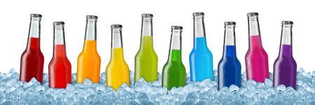 row of colorful soft drinks on ice Foto de archivo