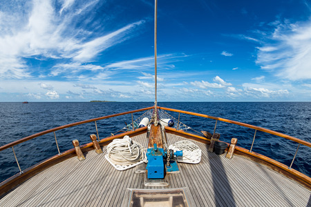 ship bow: Sailing boat on the wide open ocean