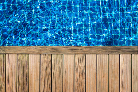 the surface of the water: wooden planks above swimming pool surface Stock Photo