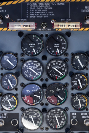 altimeter: airplane dashboard with many circular instruments Stock Photo